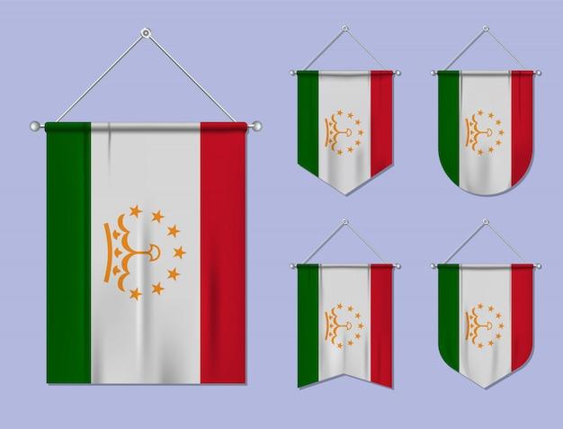 Set hangende vlaggen tadzjikistan met textiel patroon. diversiteitsvormen van het land van de nationale vlag. verticale sjabloonwimpel.