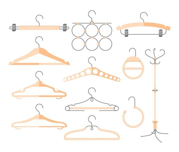 Set hangers voor verschillende kleding - moderne vector realistische geïsoleerde illustraties op witte achtergrond. kledingkast, mode of verkoop concept. collectie van verschillende vormen, vormen. houten kleur
