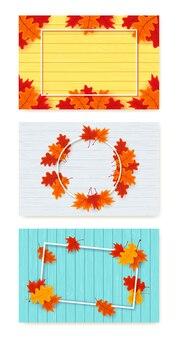 Set herfstbladeren, houten structuur en leeg frame