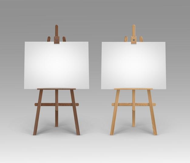 Set houten bruine sienna-ezels met blanco horizontale doeken Premium Vector