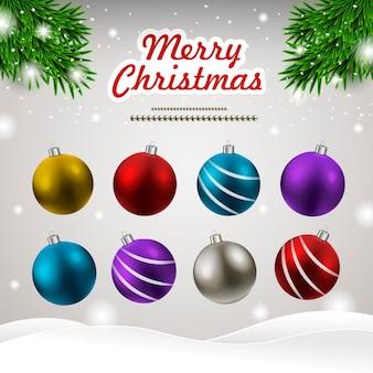 Set kerstballen geïsoleerd op besneeuwde achtergrond