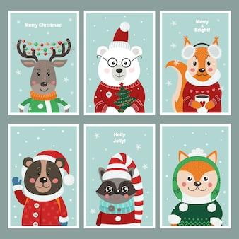 Set kerstkaarten met schattige dieren in het bos.