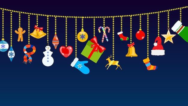 Set kerstsymbolen en warme winterkleren in vlakke stijl die aan touwen van ballen hangen