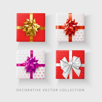 Set kleur decoratieve geschenken met harten patroon en satijnen strik. bovenaanzicht