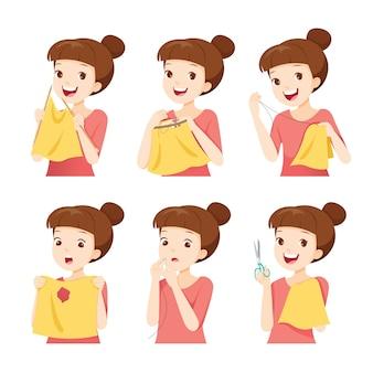 Set meisje naaien kleding, borduren en stof herstellen door handen