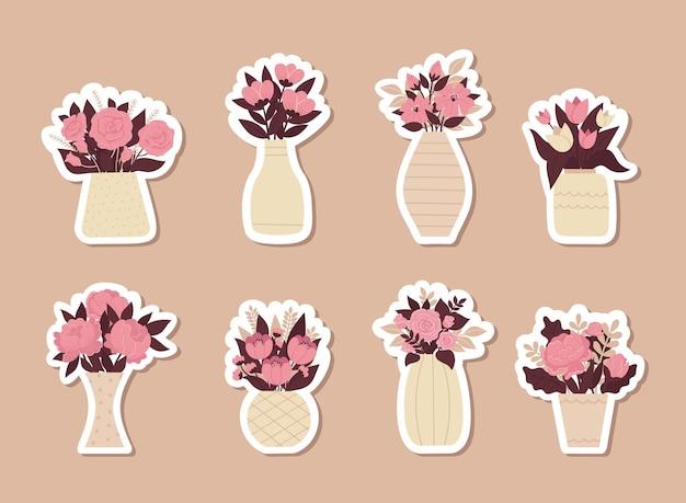 Set mooie stijlvolle stickers met boeket bloemen in vazen