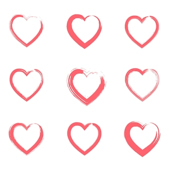 Set overzicht grunge borstels rode getextureerde harten