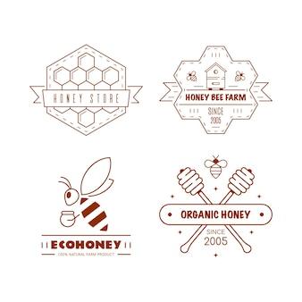 Set overzichtsjablonen logo ontwerp. biologische en eco-honingetiketten die op wit worden geïsoleerd. honingproductiebedrijf, honingpakket.
