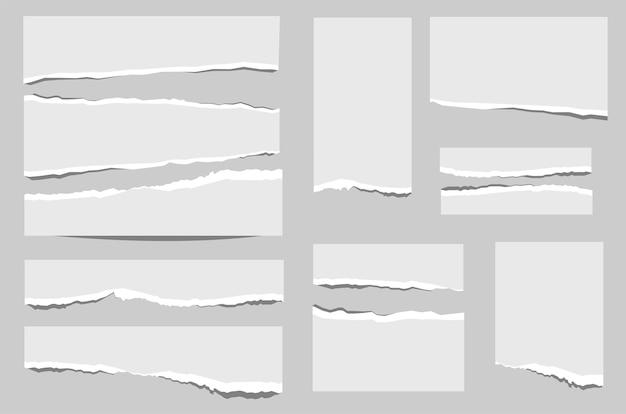 Set papier van verschillende vormen kladjes geïsoleerd op een grijze achtergrond.