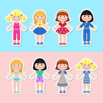 Set papieren meisjespoppen in verschillende kleding.