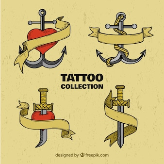 Set retro hand getekende ankers en zwaarden tattoos