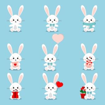 Set schattige witte konijnen in zittende houding met verschillende dingen in zijn poten