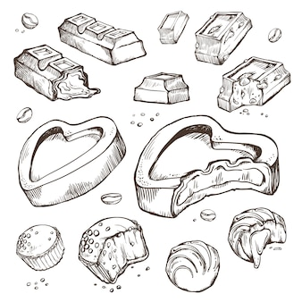 Set schetsen gebeten chocolaatjes. zoete broodjes, repen, geglazuurd, cacaobonen. geïsoleerde objecten op een wit