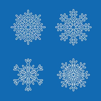Set sneeuwvlokken geïsoleerd op blauw