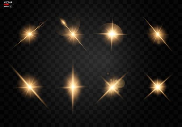 Set. stralende ster, de zonnedeeltjes en vonken met een hoogtepunteffect, gouden bokehlichten schitteren en pailletten.