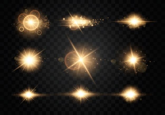 Set. stralende ster, de zonnedeeltjes en vonken met een hoogtepunteffect, kleuren bokeh lichten glitter en pailletten