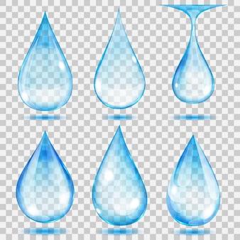 Set transparante druppels in lichtblauwe kleuren. .