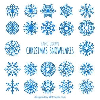 Set van abstracte sneeuwvlokken in blauwe kleur
