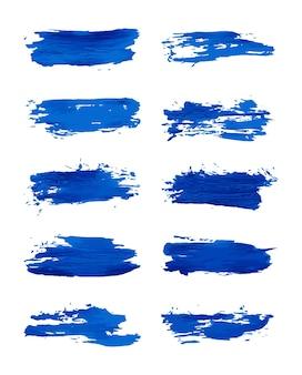 Set van blauwe grunge borstels slagen penseelstreken met een droge borstel