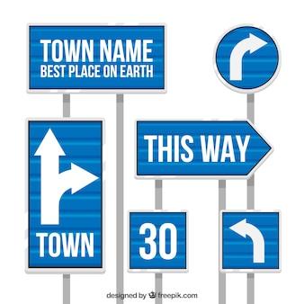 Set van blauwe verkeersborden in platte ontwerp