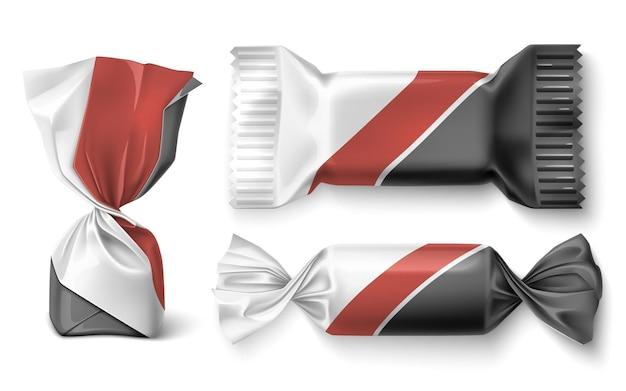 Set van chocolade snoepjes in wrapper. snoep ontwerp. realistische vectorillustratie.