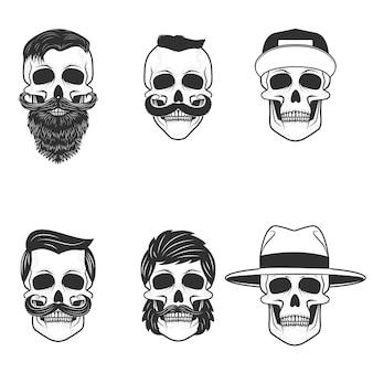 Set van de schedels met kapsel en hoeden.