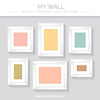 Set van decoratieve foto frames op de muur