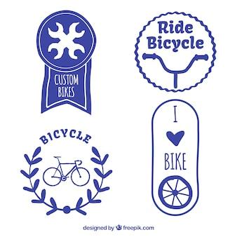 Set van decoratieve hand beschilderde blauwe fiets badges