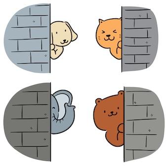 Set van dieren verstopt achter muur