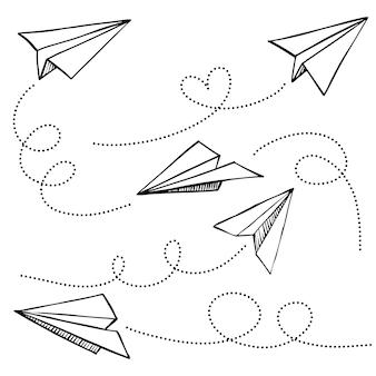Set van doodle papier vliegtuigpictogram. hand getekend papieren vliegtuigje. vectorillustratie.
