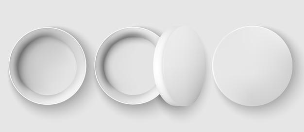 Set van drie potjes, eenmaal geopend, één met deksel erop en één gesloten. realistisch.