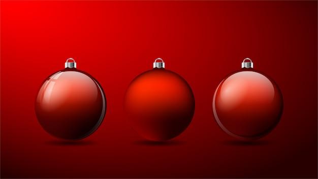 Set van drie rode 3d-kerstballen met schaduwen Premium Vector