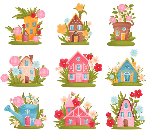 Set van fantastische huizen in de vorm van gieters, laarzen, bloempot tussen de bloemen en gras.