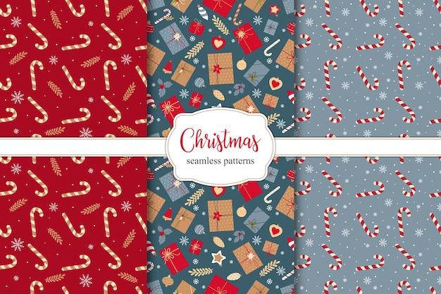 Set van feestelijke kerst naadloze patronen met kerstcadeaus, snoepjes en kerstversieringen.