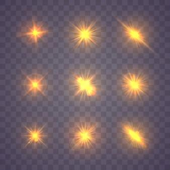 Set van geelgoud gloeiend licht ontploft op transparant