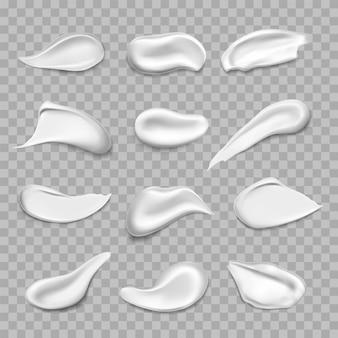 Set van geïsoleerde crème-uitstrijkjes of witte vlekken realistische gezichtsscrub of gelmousse of verfspatten