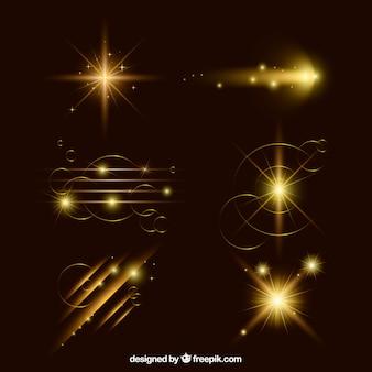 Set van gouden lens flare met realistische stijl