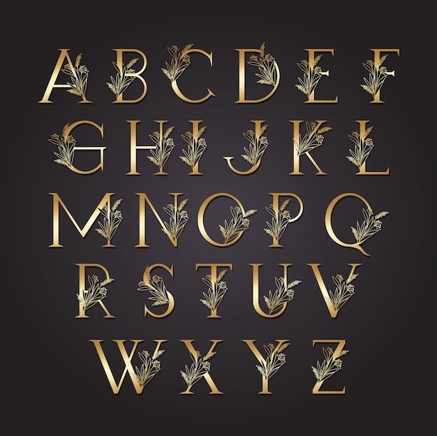 Set van gouden letters met bladeren