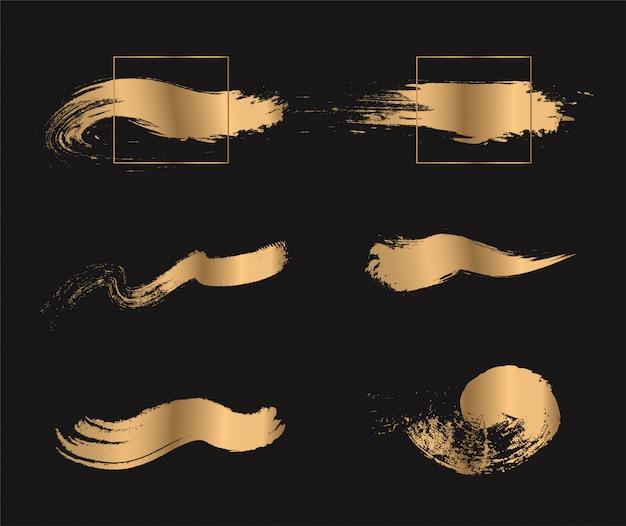 Set van gouden verf penseelstreken.