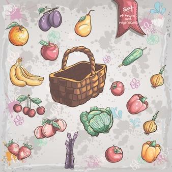 Set van groenten en fruit met een rieten mand Premium Vector