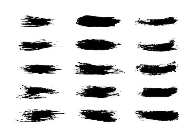 Set van grunge brushes slagen penseelstreken met een droge penseel abstracte inktvlekken