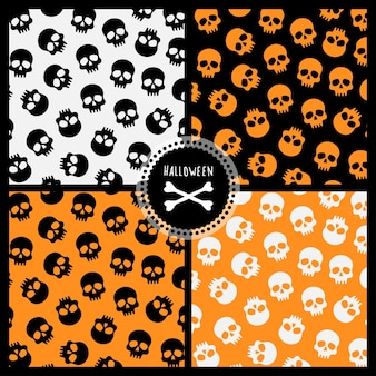Set van halloween-patronen met schedels vier vector naadloze patronen