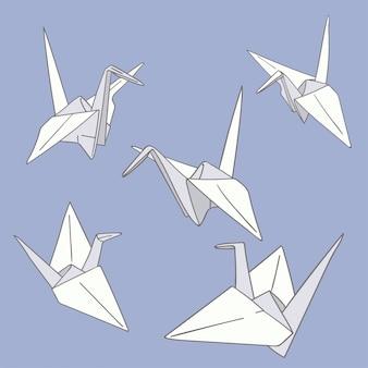 Set van hand getrokken papieren origami vogels op de blauwe