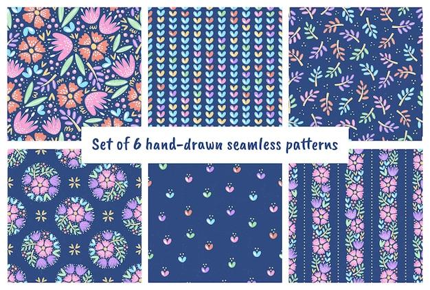 Set van handgetekende naadloze patronen schattige bloemen kleurrijke bloemenillustraties met textuur