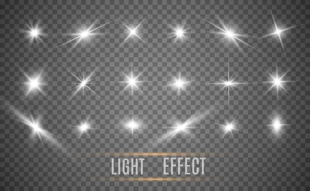 Set van heldere mooie sterren. lichteffect. heldere ster. prachtig licht om te illustreren. kerstster. witte glitter schittert met speciaal lichteffect. schittert op een transparante achtergrond.