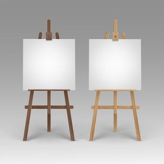 Set van houten bruine sienna-schildersezels met mock-up lege lege vierkante doeken geïsoleerd op achtergrond