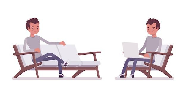 Set van jonge knappe man zit met laptop