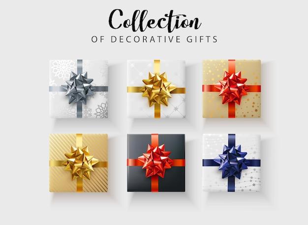 Set van kleurrijke decoratieve geschenken met satijnen strik geïsoleerd. bovenaanzicht