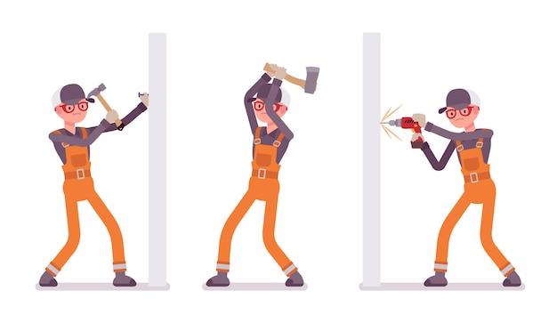 Set van mannelijke werknemer in oranje algehele nailling, boren