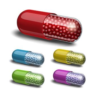 Set van medische capsule met korrels op witte achtergrond.